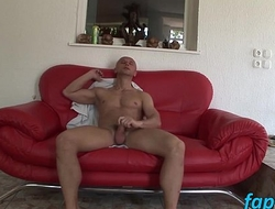 Muscular stud Nico Blade loves jerking his gherkin on sofa
