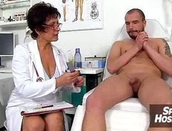 Clinic exam and wank-job from Euro big tits cougar Greta
