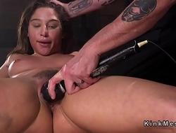 Brunette in extreme bondage toyed